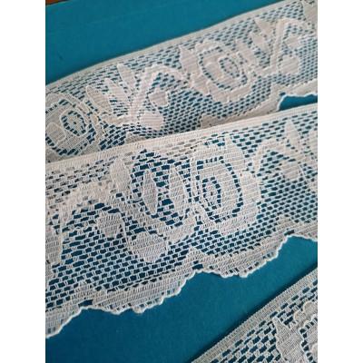 Encaje de nylon rigido blanco con flores altura cm.5 paquete mt.15